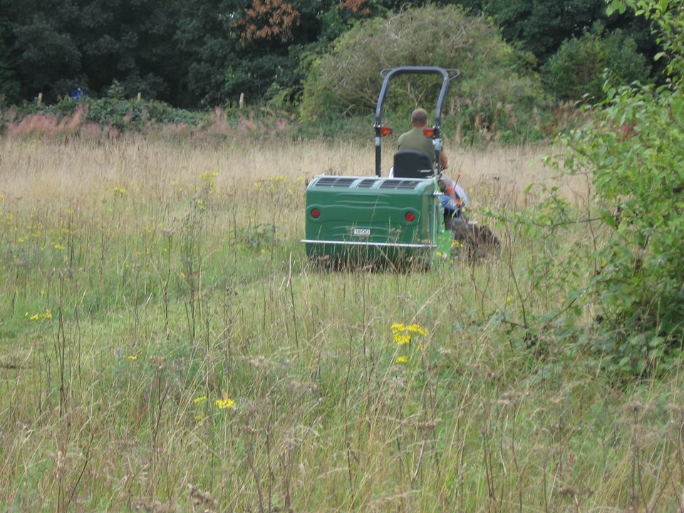 Sutton's Biodiversity Officer Dave on the flail collector, mowing the 'receptor' site.